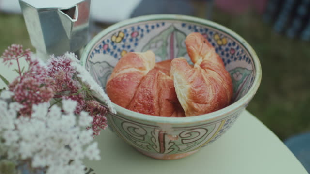 beautiful ceramic bowl with fresh croissants - croissant stock videos & royalty-free footage