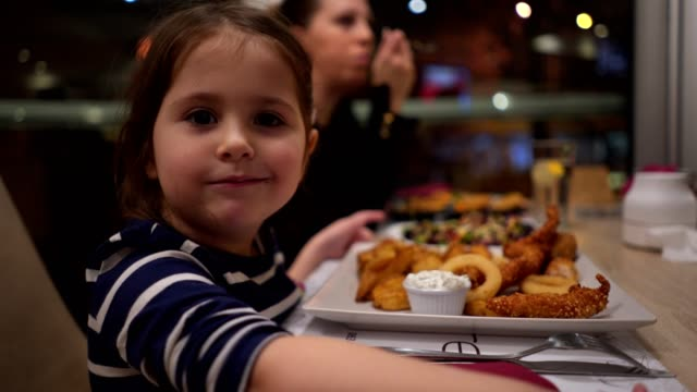 beautiful child enjoying a meal with mother - dining stock videos & royalty-free footage