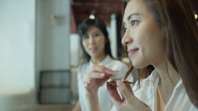 beautiful chinese woman drinking tea from japanese style tea cup - chinese tea cup stock videos and b-roll footage