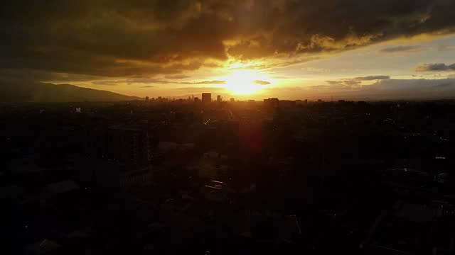 beautiful cinematic aerial view of a sunset of the city of san jose costa rica - town stock videos & royalty-free footage