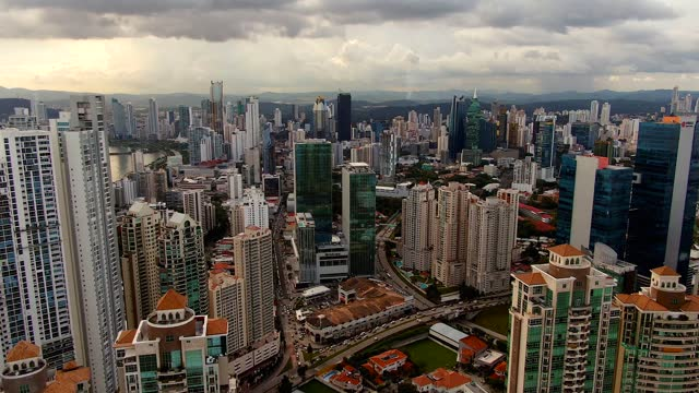 beautiful cinematic aerial view of the panama city skyscrapers and buildings - 顕花植物点の映像素材/bロール