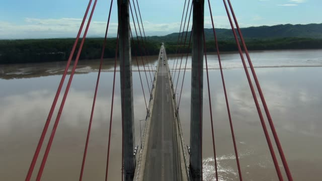 beautiful cinematic aerial view of the tempisque river and the taiwan friendship bridge in costa rica - puente golden gate stock videos & royalty-free footage