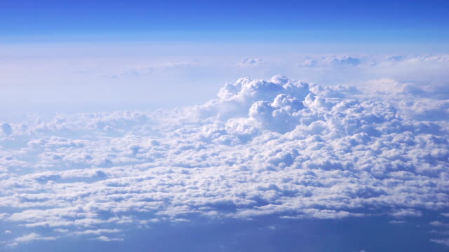 aerial beautiful clouds in blue sky taken from airplane - god stock videos & royalty-free footage