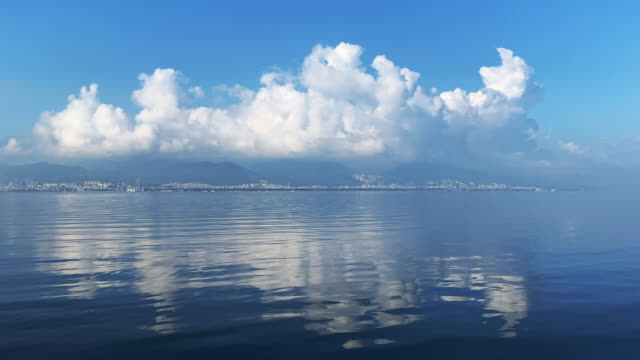 beautiful clouds over city and sea - horizon over land stock videos & royalty-free footage