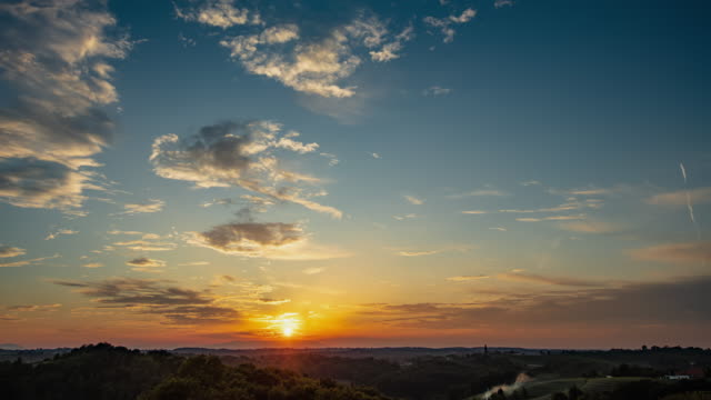 t/l beautiful cloudscape at sunset - horizon stock videos & royalty-free footage
