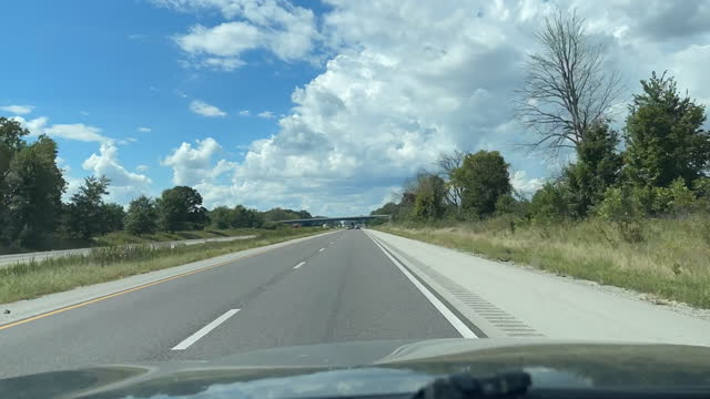 beautiful cloudscapes in time lapse interstate travel midwest plains missouri and illinois daytime driving time lapse slow motion real time video series - motorway stock videos & royalty-free footage