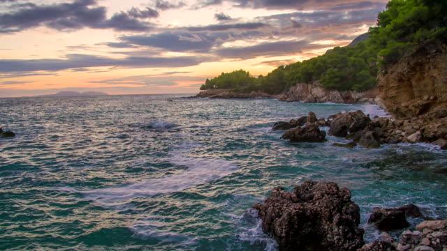 slo mo beautiful coast at dusk - rocky coastline stock videos & royalty-free footage