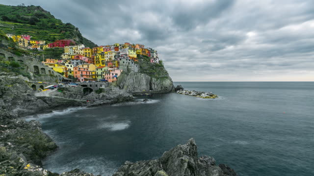 Beautiful colorful cityscape on the village of manarola, Cinque Terre coast at sunset, Italy