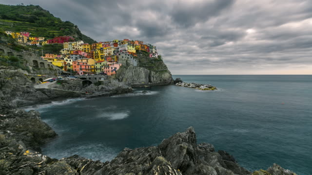 beautiful colorful cityscape on the village of manarola, cinque terre coast at sunset, italy - five objects stock videos and b-roll footage