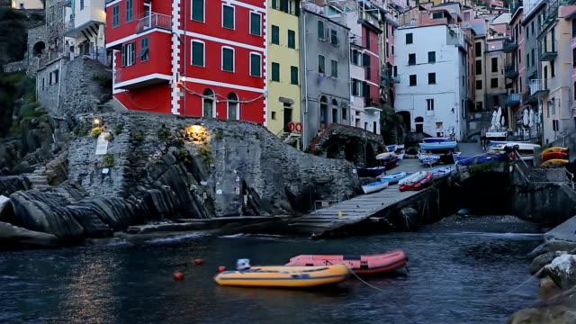 beautiful colorful cityscape on the village of riomaggiore, cinque terre coast in italy. - italian culture stock videos & royalty-free footage