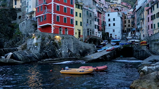 beautiful colorful cityscape on the village of riomaggiore, cinque terre coast in italy. - cultura mediterranea video stock e b–roll