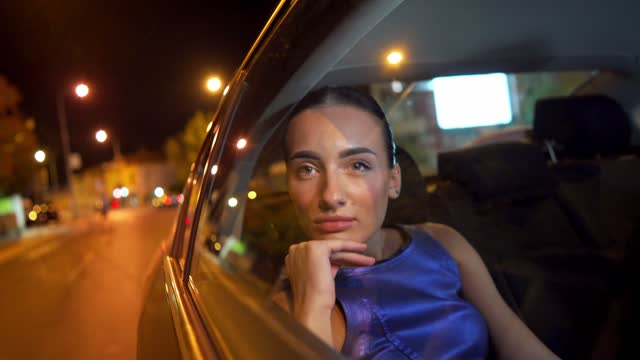 beautiful contemplating young woman riding on a back seat of a car - car interior stock videos & royalty-free footage