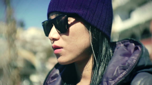 beautiful cool urban young woman wear sunglasses. - cap stock videos & royalty-free footage