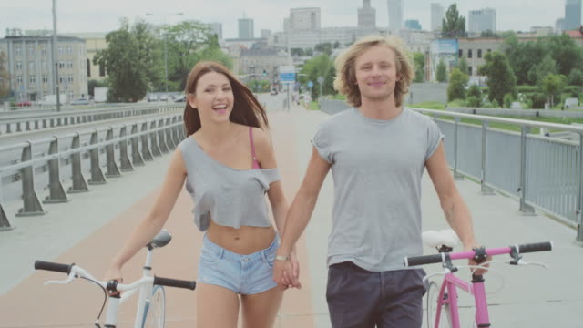 Beautiful couple cycling in the city
