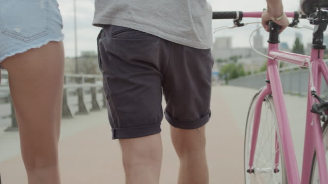 beautiful couple cycling in the city - musical instrument bridge stock videos & royalty-free footage