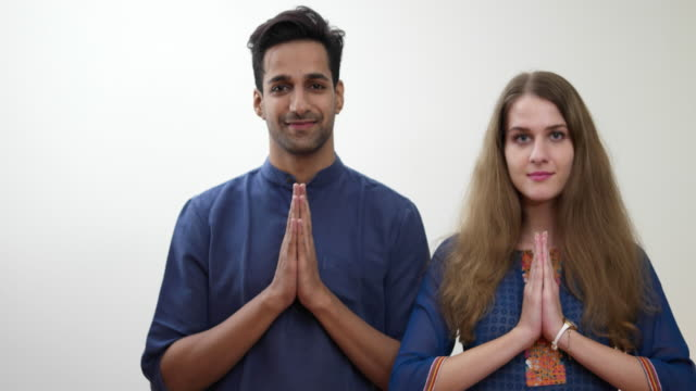 beautiful couple in indian attire, joining hands for the indian 'namaste' greeting - gesturing stock videos & royalty-free footage