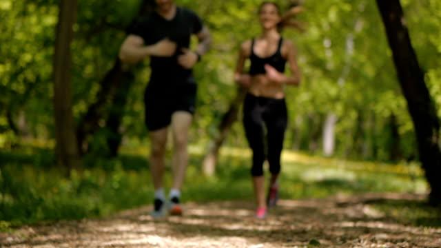 beautiful couple jogging in the public park.  belgrade, serbia, europe - public park stock videos & royalty-free footage