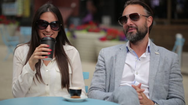 beautiful couple sitting a manhattan cafe - food and drink stock videos & royalty-free footage