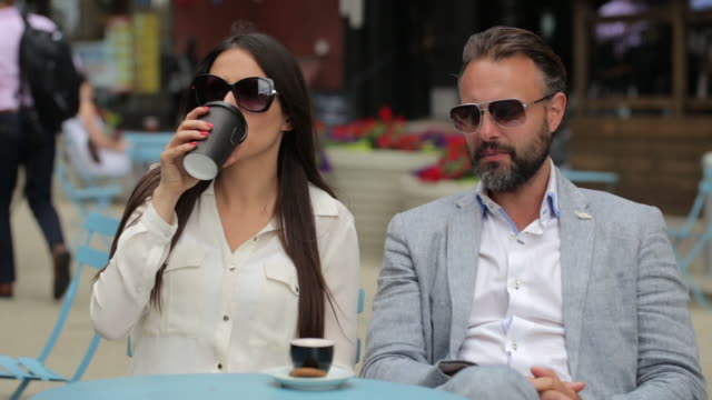 beautiful couple sitting a manhattan cafe - fashionable stock videos & royalty-free footage