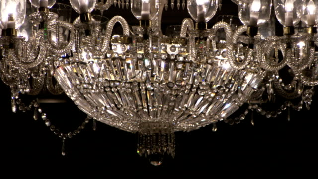 A beautiful crystal chandelier hangs from the ceiling of the Taj Mahal Hotel dining room. Available in HD.