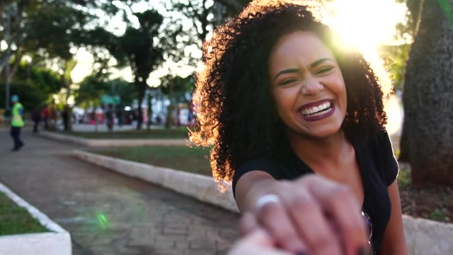 beautiful curly hair woman holding hands/following boyfriend - personal perspective stock videos & royalty-free footage