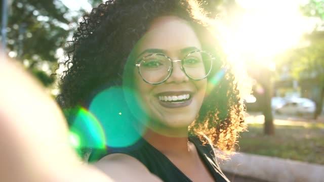 beautiful curly hair woman taking a selfie - pardo brazilian stock videos & royalty-free footage