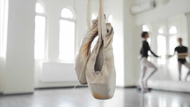 beautiful dancer stretching and exercising at the barre. - ballet shoe stock videos and b-roll footage