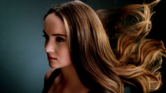 beautiful dark blond woman tossing her long hair - long hair stock videos & royalty-free footage