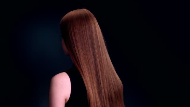 beautiful dark blond woman tossing long hair - hair treatment stock videos and b-roll footage