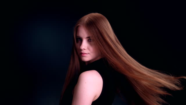 beautiful dark blond woman tossing long hair - straight hair stock videos & royalty-free footage