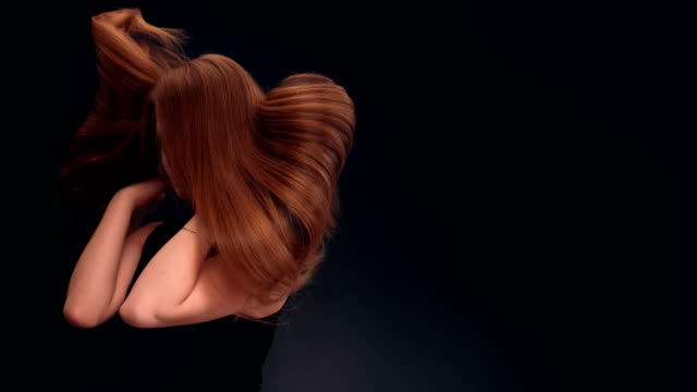 beautiful dark blond woman tossing long hair - hair straighteners stock videos and b-roll footage
