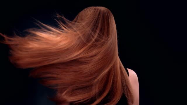 Beautiful dark blond woman tossing long hair