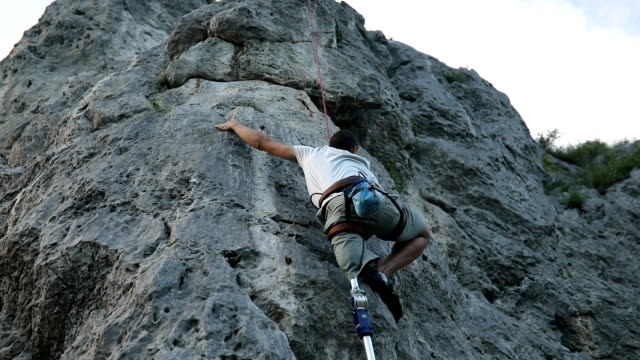 beautiful day for free climbing - amputee stock videos & royalty-free footage