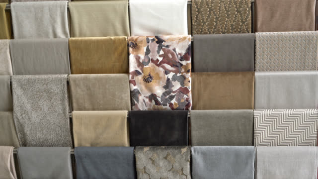 beautiful design of fabrics at a textile store - espositore per negozio video stock e b–roll