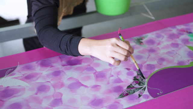 beautiful design on the batik being coloured - batik stock videos and b-roll footage