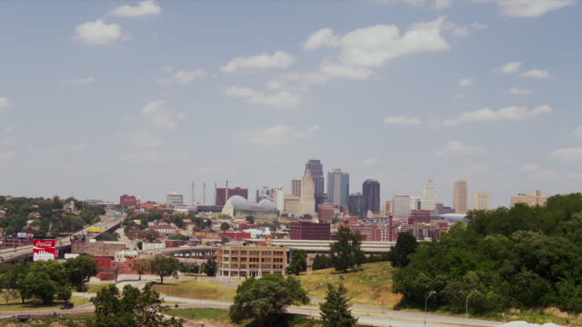 Beautiful downtown Kansas City Cityscape skyline with buildings blue sky and white clouds