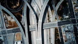 Beautiful drone flyover above large highway junction interchange with complex structure of multiple roads and flyovers.