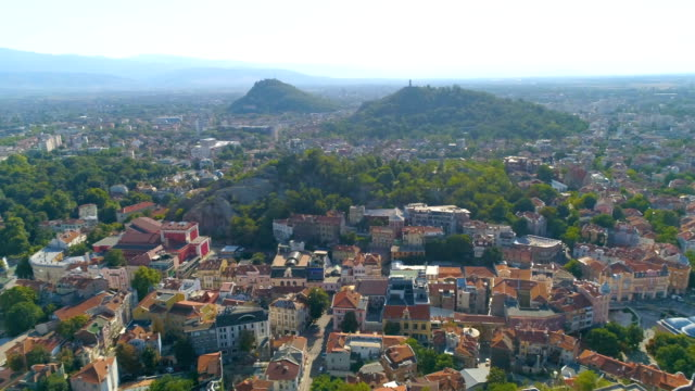 beautiful drone shot 360 degree rotation panorama over the city of plovdiv in bulgaria - bulgaria stock videos & royalty-free footage