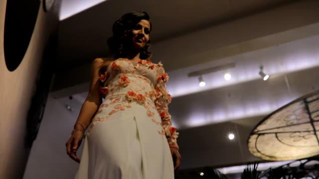 beautiful elegant woman in white dress walking down the steps - beautiful people stock videos & royalty-free footage