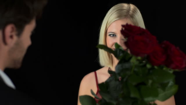 hd: beautiful elegant woman receiving red roses - evening gown stock videos & royalty-free footage