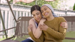 Beautiful Ethnic Female With Cancer Embracing Her Sister