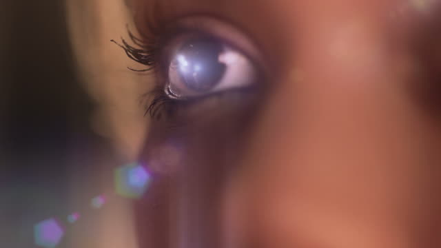 beautiful eye reflex with flare - eye close up stock videos and b-roll footage