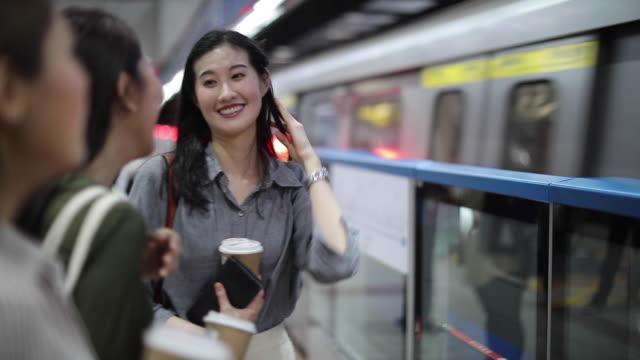 beautiful female friends waiting for subway train - viso naturale video stock e b–roll