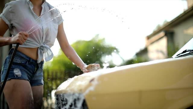 beautiful female having fun during car wash - pin up girl stock videos & royalty-free footage
