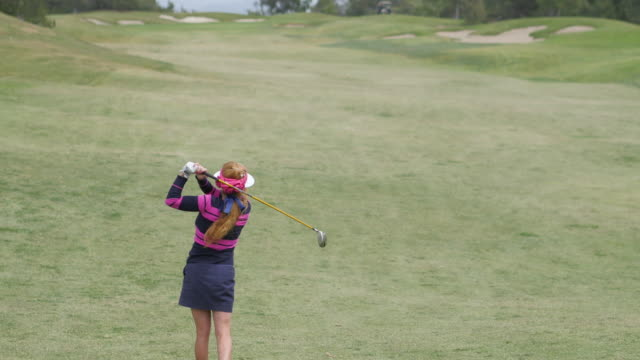 beautiful female professional golfer plays golf - golf links stock videos & royalty-free footage