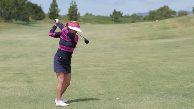 beautiful female professional golfer plays golf - links golf stock videos & royalty-free footage