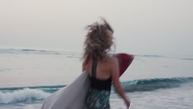 vidéos et rushes de beautiful female surfer running with board in bag in ocean - surf