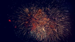 Beautiful fireworks displayed in a dark sky. 4K.