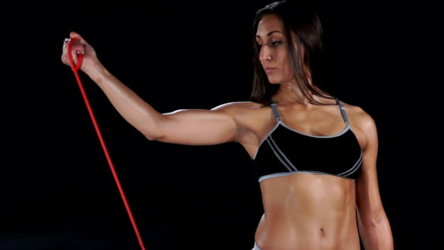 beautiful fit girl doing shoulder exercise with resistance band - bicep stock videos and b-roll footage