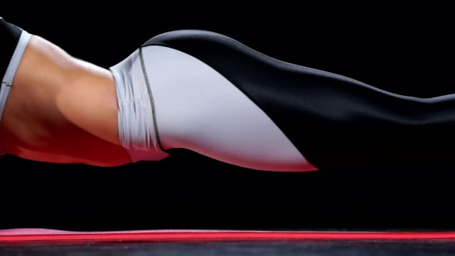 Beautiful fit girl in plank position